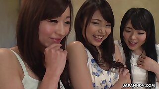 Three hot Japanese women enjoying a mind squalid group sex with her friends