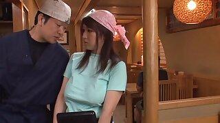 Slutty Rina Araki moans while being pleasured by a big cucumber