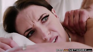 Busty brunette Angela White bangs on the massage table