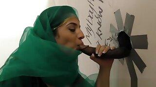 Pretty Pakistani babe visits the gloryhole for black cock