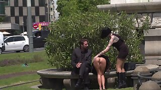 Outdoor sexual fun in the park with a couple and their slave girl