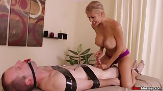 Stacked and slutty masseuse subjects client to enslavement and teasing handjob